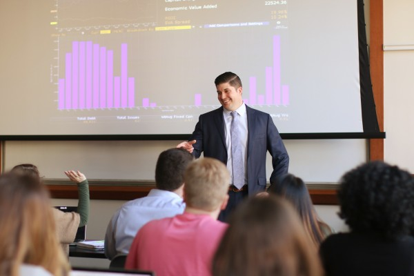 A student demonstrates his ability in data analytics at the Ohio State University Fisher College of Business' Specialized Master in Business Analytics.