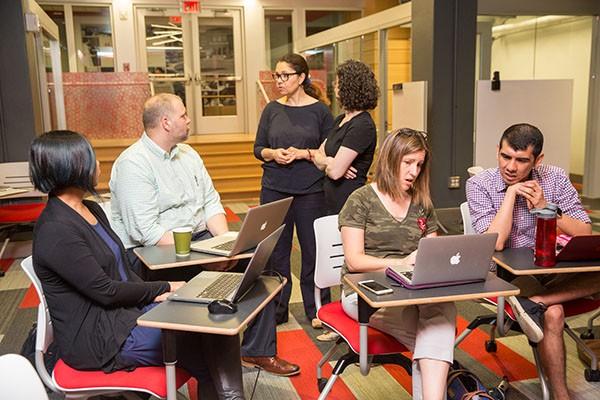 a group of instructors at Kickstart Week talk together