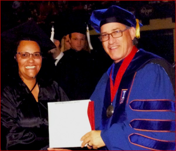 Winnie Sampson accepting her degree from her supervisor Dr. Tomasko at Ohio State