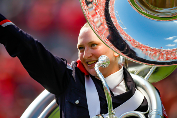 Lindsay Hosteler holds her sousaphone and gestures to the crowd during an Ohio State football game