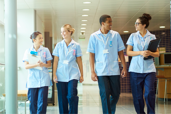 Nursing students walk down the hallway in a hospital