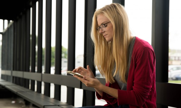 Woman with smartphone sitting
