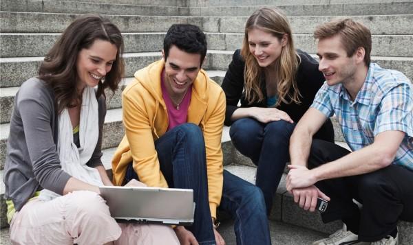 decorative image of people gathered around laptop