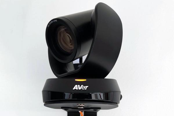 A black, wall-mounted web camera