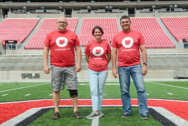 Three teachers from Hilliard City Schools pose wearing College Ready Ohio T-shirts.