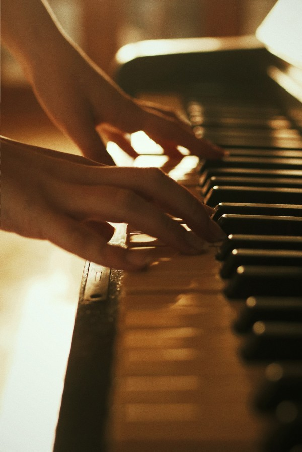 A pair of hands playing piano